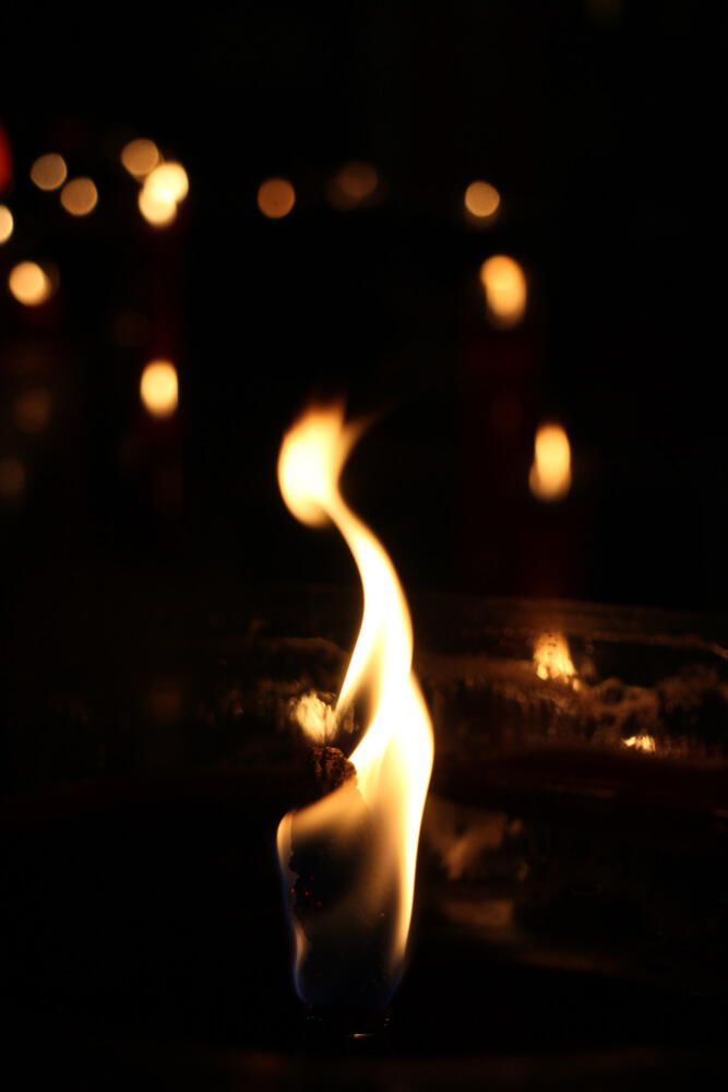 Focus-on-the-flame-of-a-candle-burning-away-fast
